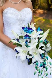 wedding flowers blue and white image result for white lilies bouquet with blue flowers
