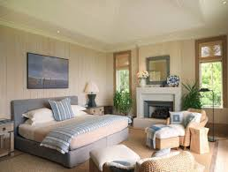 master bedroom cottage style with fireplace and wall art and