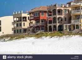 a row of houses along the beach in destin florida stock photo