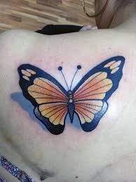 made this butterfly on the back shoulder blade area com