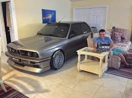 bmw owner goes viral after parking car in living room to protect