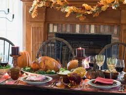 table with turkey in front of fireplace usa stock
