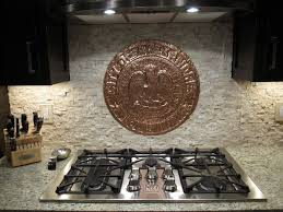 kitchen backsplash with copper medallion accent by jl peyton