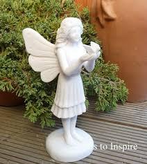 enigma marble resin standing garden ornament woodside