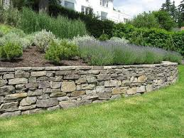 building a stone retaining wall jcs landscaping