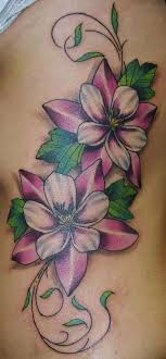 vine flower on rib ink flower tattoos