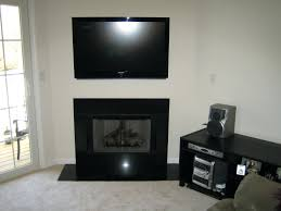 mounting a tv over a fireplace 4k ultra hd tv mounted over stone