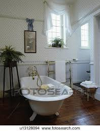 Striped Wallpaper Bathroom Stock Photo Of Rolltop Bath In Centre Of Traditional Bathroom With