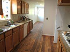 Kitchen Vinyl Flooring by Oak Cabinets And Hardwood Floors From Painted Dark Oak Cabinets