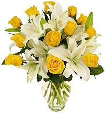 roses and lilies benchmark bouquets yellow roses and white