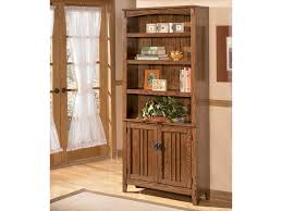 Bookcase With Door by Ashley Furniture Cross Island Large Door Bookcase Royal