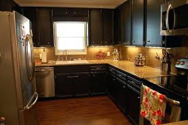 Distressed Black Kitchen Cabinets by Red And Black Distressed Kitchen Cabinets Wet Bar Area Painted