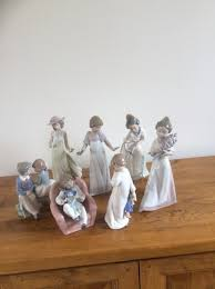 assortment of lladro and nao ornaments all in immaculate condition