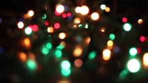 black colored christmas lights defocused colorful lights flickering on black background stock