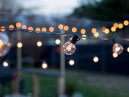 string lights outdoor how to hang outdoor string lights from diy posts hgtv