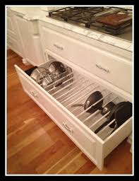 kitchen cabinet organizers for pots and pans kitchen drawer pan and lids organizing jpg 530 690 ピクセル 収納