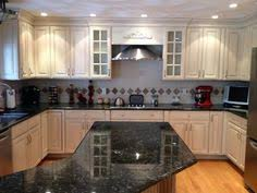Glazing Kitchen Cabinets Before And After by Glazed Kitchen Cabinet Makeover Here A Dark Kitchen Is Painted