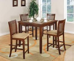 kitchen table with matching bar stools alng floor lamp nickel