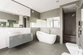 white and grey exclusive big washroom with fancy bath stock photo