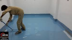 installation of self levelling epoxy flooring at ice cream factory