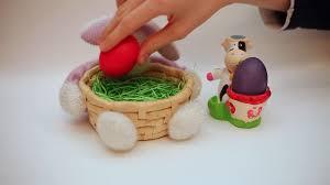 bunny basket eggs putting easter eggs in bunny egg holders bunny basket