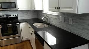 black countertop with black sink black granite island countertop black bar stools with metal legs