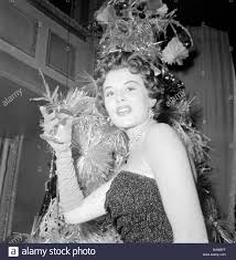mrs eunice gayson at the room 21 christmas party december stock