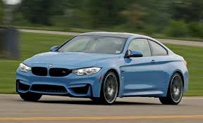 bmw m4 reviews bmw m4 price photos and specs car and driver