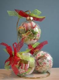 rolled up scrapbook paper inside clear ornaments i made
