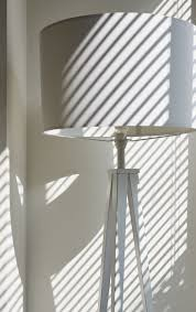 a dramatic light effect created by horizontal blinds luminous