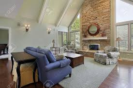 family room with two story stone fireplace stock photo picture