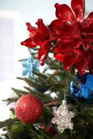day 14 pretty tree toppers traditional home brilliant faux poinsettias look great year after year and put a whole lot of bright and cheery red into your holiday palette