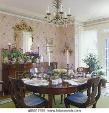 Mirror Over Dining Room Table - stock image of dining room traditional greek revival formal