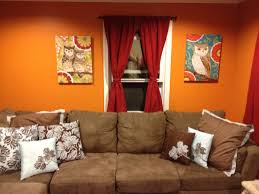 living room brown couch with gray walls and decorative small wall