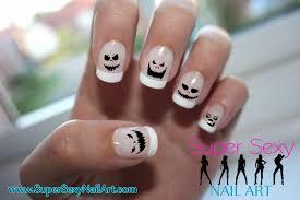 halloween scary pumpkin nail art skullsandstuff
