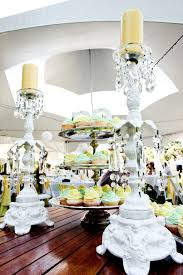 white wedding reception tent hung with chandeliers adorned with