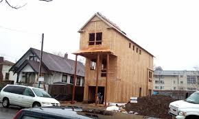 skinny house under construction victim of a subdivided lot