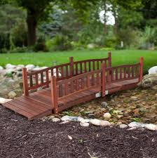 wooden garden bridge wood yard pond outdoor walkway creek foot