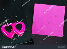 heart shaped writing paper pink love heart shaped earrings on black display with note card save to a lightbox