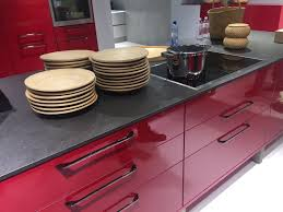 elegant red kitchen cabinets black marble top with sink faucet