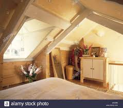 Attic Bedroom by Velux Window Above Bed In Attic Bedroom With Simple Economy Style
