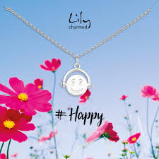 silver emoji spinner necklace with happy message charmed