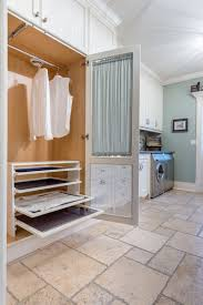 Laundry Room Storage Between Washer And Dryer by Brilliant Ways To Organize And Add Storage To Laundry Rooms