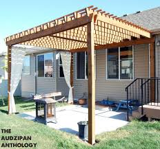 wooden backyard deck with outdoor table chairs and shade umbrella