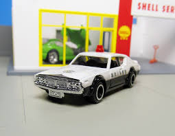 tomica nissan march 0 jpg