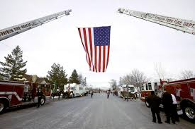 Fallen Officer Flag Community Shows Its Support For Fallen Officer During Procession