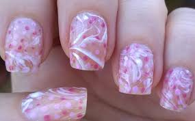 life world women negative space water marble nail art in pink u0026 white