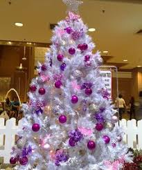 white tree with purple lights happy holidays