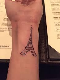 left wrist outline eiffel tower tattoo