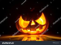 halloween black background image halloween scary face pumpkin on black background stock photo